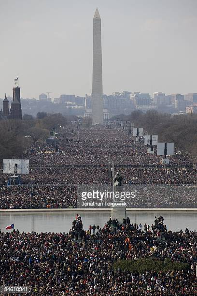 Americans watch during the inauguration of Barack Obama as the 44th President of the United States of America on the National Mall January 20 2009 in...