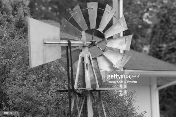 american-style windmill by plants - american style windmill stock pictures, royalty-free photos & images