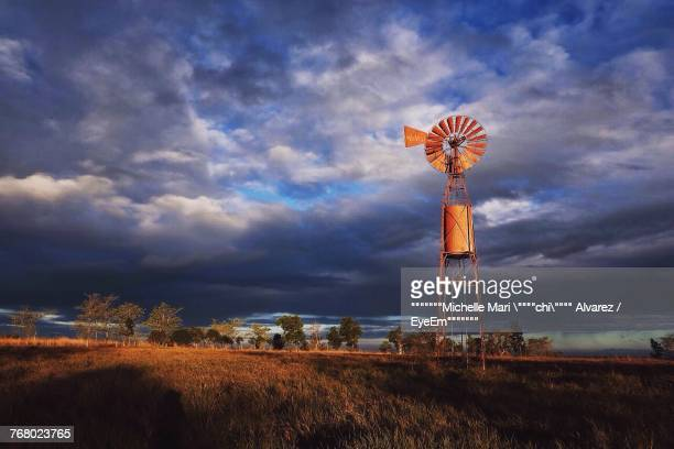 American-Style Windmill On Field Against Sky