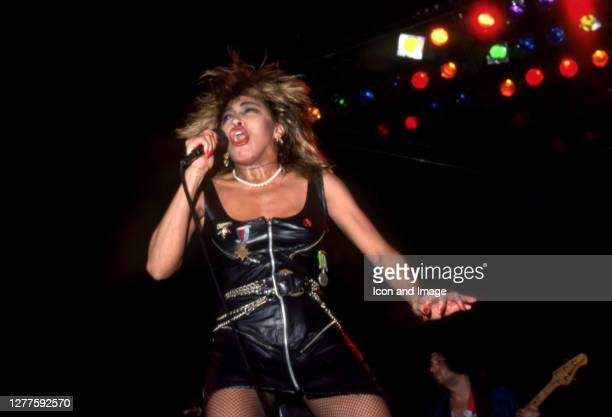 """American-Swiss singer and actress, Tina Turner performs at the Joe Louis Arena during her """"Private Dancer Tour"""" on August 18 in Detroit, Michigan."""