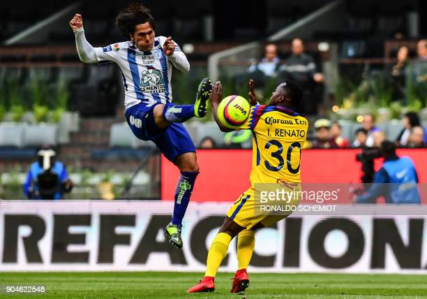 America´s Alex Ibarra vies for the ball with Jose Martinez of Pachuca during their Mexican Clausura 2018 tournament football match at the Azteca...