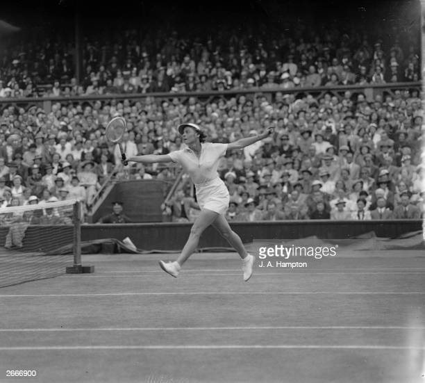America's Alice Marble stretches to return a shot from Polish player Jed Jedrzejowska during a women's singles semifinal on the centre court at...