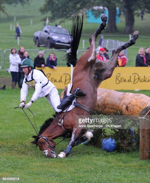 America's Clark Montgomery falls from his horse Universe as they compete in the CIC3* cross country event during the Bramham International Horse...