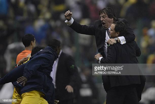 America's coach Miguel Herrera celebrates the second goal against Cruz Azul during the Mexican Clausura tournament final match at the Azteca stadium...