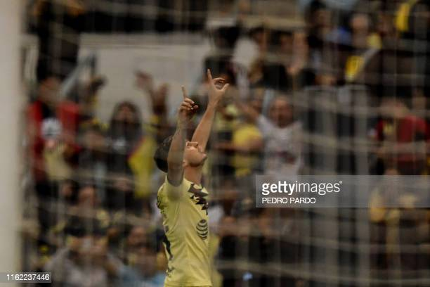 America´s Colombian midfielder Nicolas Benedetti celebrates after scoring during a Mexican Apertura football tournament match against Morelia at the...