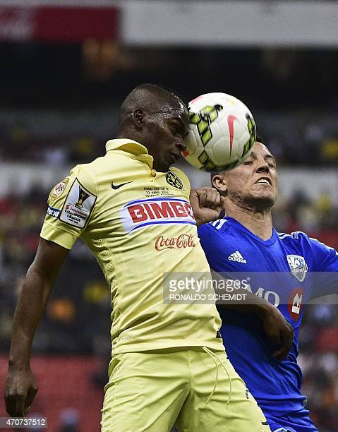America's Darwin Quintero from Mexico vies for the ball with Dony Toia of Montreal Impact of Canada during their CONCACAF Champions League first leg...