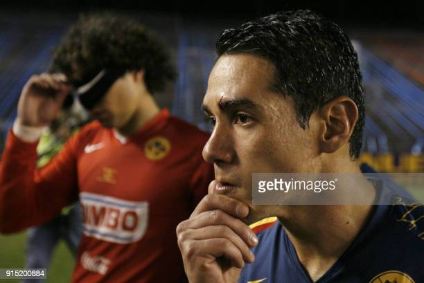 FC America's defender Ismael Rodriguez and goalkeeper Francisco Ochoa react after being defeated in the final match of the Copa Sudamericana 2007 by...