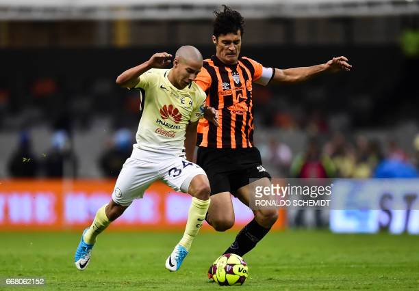 America´s Diego Lainez vies for the ball with Necaxa´s MArcos Gonzalez during their Mexican Clausura 2017 tournament football match at the Azteca...
