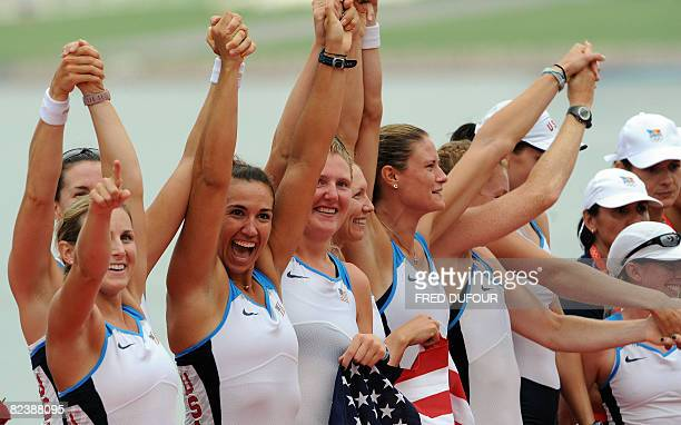 America's Erin Cafaro Lindsay Shoop Anna Goodale Elle Logan Anne Cummins Susan Francia Caroline Lind Caryn Davies and Mary Whipple celebrate during...