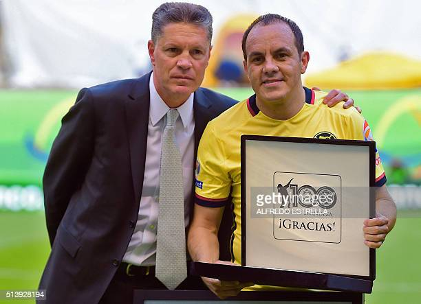 America's former football player and current Cuernavaca Mayor Cuauhtemoc Blanco poses with America's former football player Ricardo Pelaez during a...