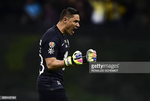 America´s goalkeeper Moises Munoz celebrates a goal against Tigres during their Mexican Apertura 2016 tournament final first leg football match at...