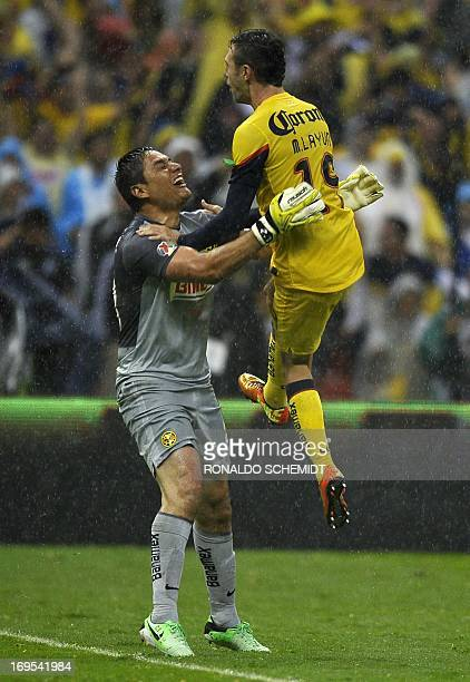 America's goalkeeper Moises Munoz celebrates with Miguel layun during Mexican Clausura tournament final against Cruz Azul by penalty kicks at Azteca...