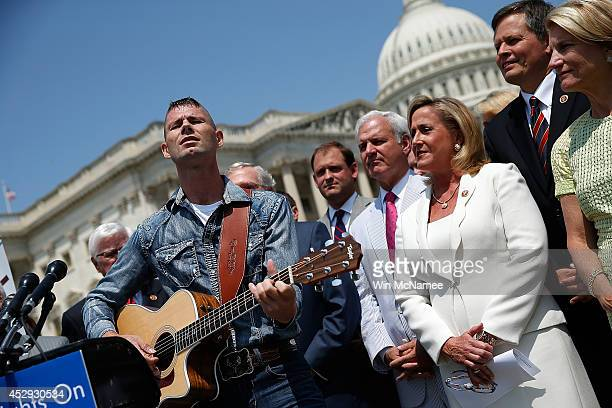 'America's Got Talent' contestant Jimmy Rose sings 'Coal Keeps the Lights On' during a news conference on proposed Environmental Protection Agency...