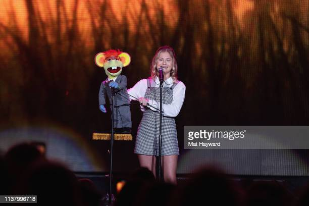 """America's Got Talent"""" season 12 champion singer and ventriloquist Darci Lynne performs on stage with her puppet Oscar The Mouse at Tacoma Dome on..."""