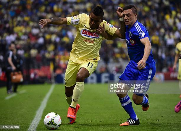 America's Michael Arroyo from Mexico vies for the ball with Dony Toia of Montreal Impact of Canada during their CONCACAF Champions League first leg...