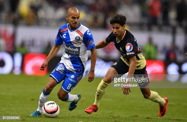 America's midfielder Diego Lainez vies for the ball with Puebla's midfielder Francisco Acuna during their 2017 Mexican Apertura Tournament football...