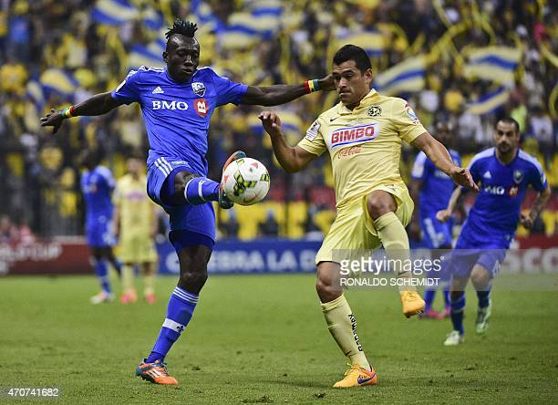 America's Miguel Zamudio from Mexico vies for the ball with Dominic Oduro of Montreal Impact of Canada during their CONCACAF Champions League first...