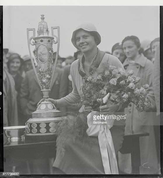 America's New Golf Queen. Salem, Mass.: Miss Virginia Van Wie of Chicago, shown with the beautiful trophy which she won by her sensational victory...