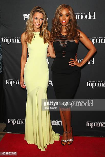 America's Next Top Model creator and host Tyra Banks poses alongside Jennifer Hawkins at Carriageworks on December 5 2014 in Sydney Australia