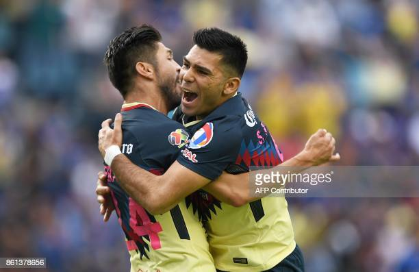 America's Oribe Peralta celebrates with Argentine teammate Silvio Romero after scoring against Cruz Azul during their Mexican Apertura football...