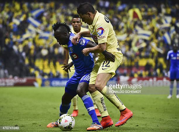 America's Pablo Aguilar from Mexico vies for the ball with Dominic Oduro of Montreal Impact of Canada during their CONCACAF Champions League first...