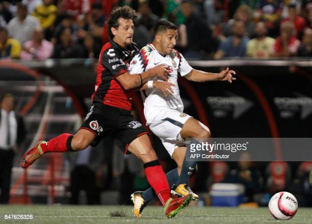 America`s Paraguayan forward Cecilio Dominguez vies for the ball with Tijuana`s Uruguayan defender Matias Aguirregaray during a Torneo Apertura 2017...