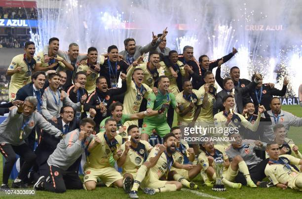 TOPSHOT America's players celebrate after defeating Cruz Azul to win the Mexican Apertura Tournament football final at the Azteca stadium in Mexico...