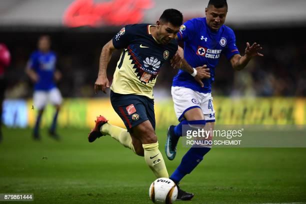 America´s Silvio Romero vies for the ball with Julio Dominguez of Cruz Azul during their quarter final Mexican Apertura 2017 tournament football...