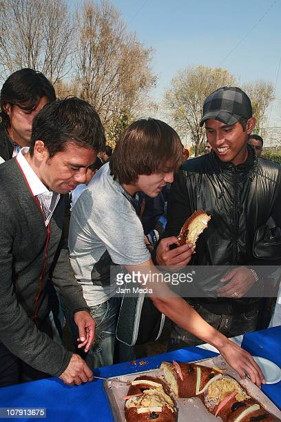 America's soccer player Pavel Pardo Joaquin Martinez and Juan Carlos Valenzuela during the delivery of toys by the club America to the foundations...