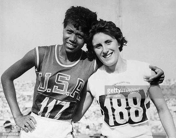 America's Wilma Rudolph of Clarksville Tennessee embraces Britain's Dorothy Hyman after Miss Rudolph won a gold Medal for the US by taking the...