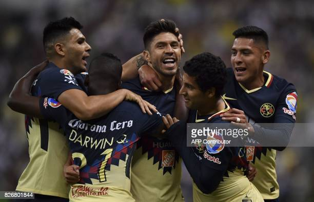 Americas's forward Oribe Peralta celebrates with teammates after scoring a goal against Pumas'during their Mexican Apertura tournament football match...