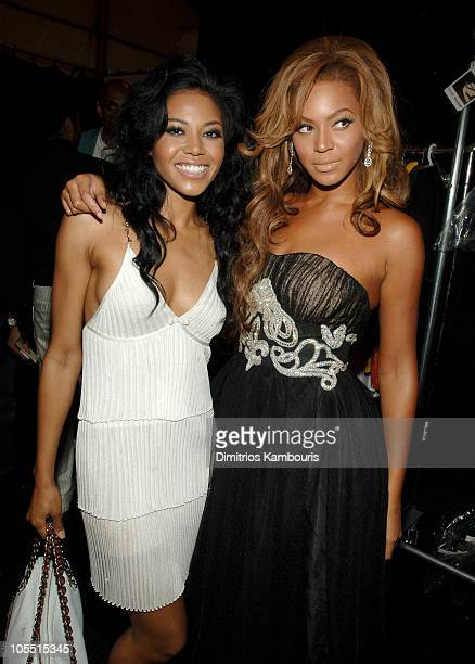 Amerie and Beyonce Knowles during Olympus Fashion Week Spring 2006 Fashion For Relief Backstage at Bryant Park in New York City New York United States