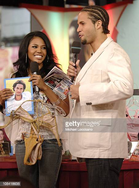 Amerie and MTV VJ Quddus during Amerie Visits MTV's TRL April 22 2005 at MTV Studios Times Square in New York City New York United States