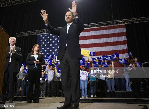 Presidential hopeful Senator Barack Obama DIL waves as he is introduced during a rally 11 February 2007 at the Hilton Coliseum of Iowa State...