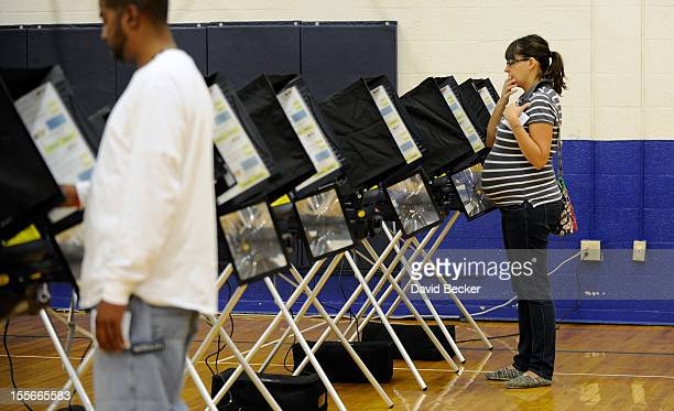 Amey Esparza casts her ballot at the polling station at John Fremont Middle School on November 6 2012 in Las Vegas Nevada Voting is underway in the...