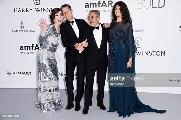 amFAr Ambassador Milla Jovovich Stefano Tonchi Afef Jnifen and guest arrive at amfAR's 23rd Cinema Against AIDS Gala at Hotel du CapEdenRoc on May 19...