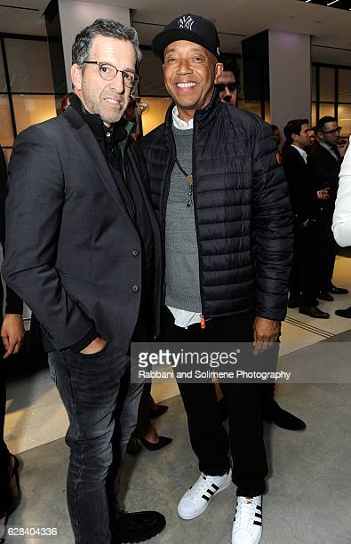 amfAR board chairman Kenneth Cole and Russell Simmons attend the 2016 amfAR GenerationCure Holiday Party at Cadillac House on December 7 2016 in New...