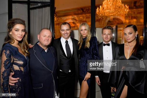 amfAR CEO Kevin Robert Frost and Milutin Gatsby attend amfAR Paris Dinner 2018 at The Peninsula Hotel on July 4 2018 in Paris France