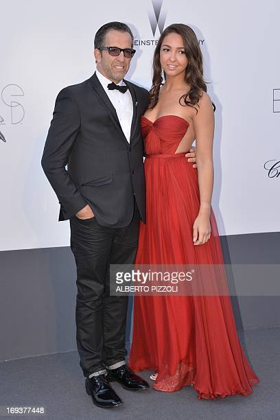 amfAR Chairman Kenneth Cole and his wife Catie pose on May 23 2013 as they arrive for the amfAR's 20th Annual Cinema Against AIDS during the 66th...