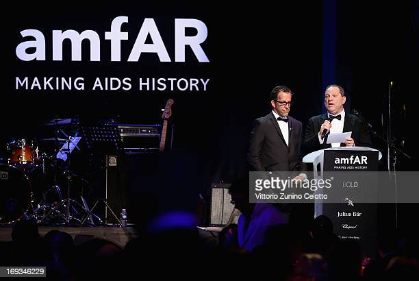 amfAR chairman Kenneth Cole and model Harvey Weinstein speak on stage at amfAR's 20th Annual Cinema Against AIDS during The 66th Annual Cannes Film...