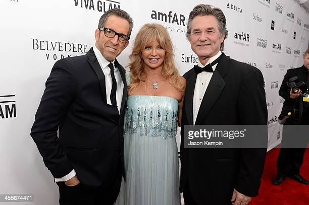 amfAR Chairman Kenneth Cole honoree Goldie Hawn and actor Kurt Russell attend the 2013 amfAR Inspiration Gala Los Angeles at Milk Studios on December...