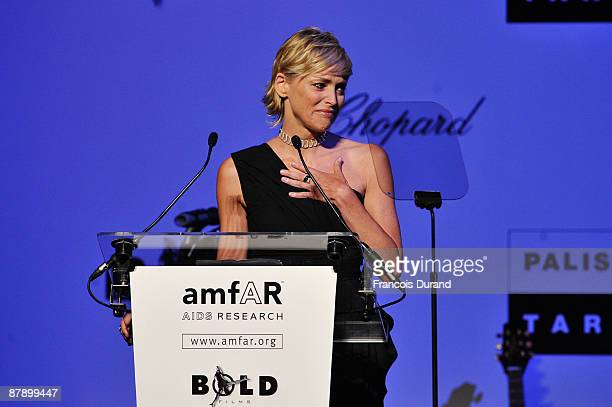 amfAR Global Fundraising Chairman Sharon Stone speaks during the amfAR Cinema Against AIDS 2009 show at the Hotel du Cap during the 62nd Annual...