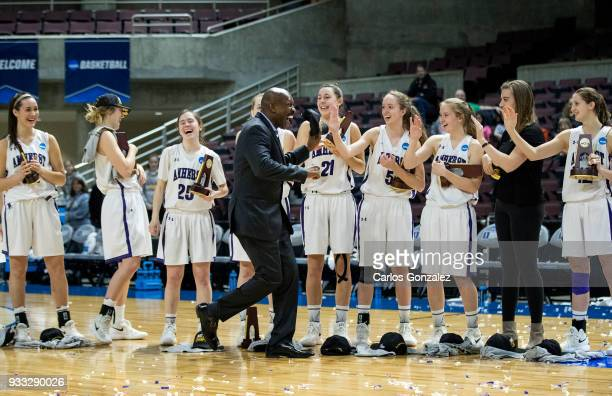 Amherst College Assistant Athletic Director Billy McBride celebrated with the team after winning the Division III Women's Basketball Championship...