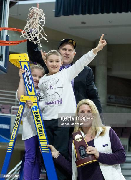 Amherst College head coach GP Gromacki posed for a photo with his family after winning the Division III Women's Basketball Championship held at the...