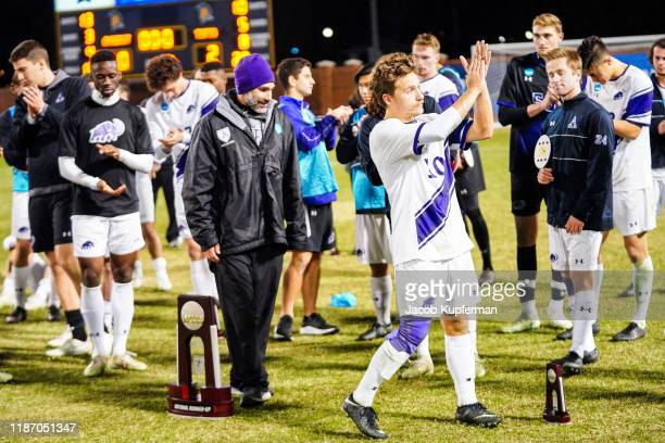 Amherst Mammoths players after their loss during the Division III Men's Soccer Championship held at UNCG Soccer Stadium on December 7 2019 in...
