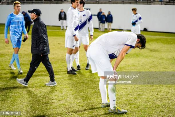 Amherst Mammoths players react after their loss during the Division III Men's Soccer Championship held at UNCG Soccer Stadium on December 7 2019 in...
