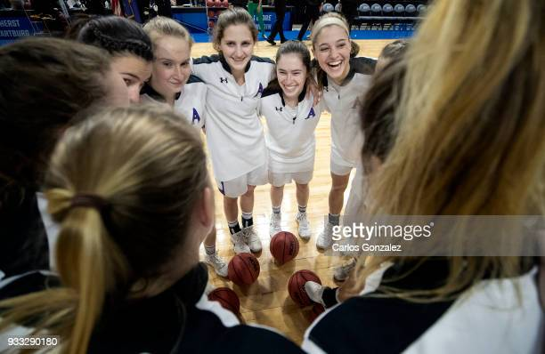 Amherst players huddled up before the start of the Division III Women's Basketball Championship held at the Mayo Civic Center on March 17 2018 in...