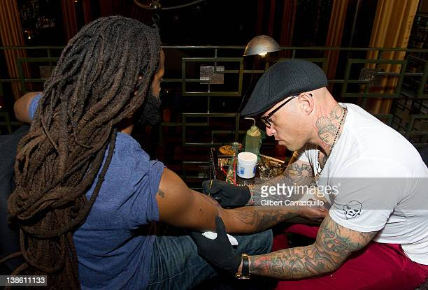 Ami James tattoos John Forte at The Ami James Ink Tattoo PopUp Shop at the Empire Hotel on February 9 2012 in New York City