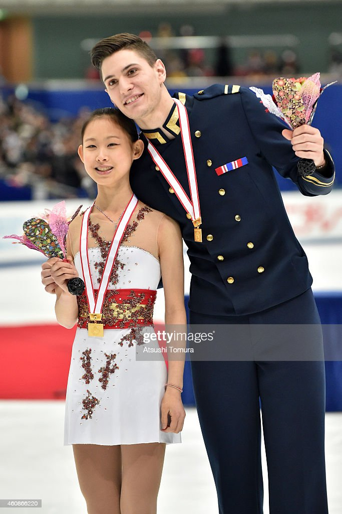 Ami Koga and Francis Boudreau Audet of Japan pose with gold medal in the award ceremony for pairs Junior during the 83rd All Japan Figure Skating Championships at the Big Hat on December 28, 2014 in Nagano, Japan.