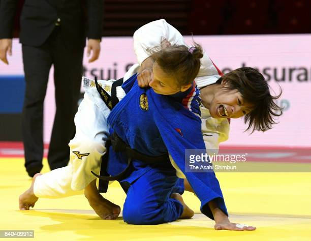 Ami Kondo of Japan and Irina Dolgova of Russia compete in the Women's 48kg quarter final during day one of the World Judo Championships at the Laszlo...